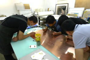 Printing Dept techies work on Copper engraving for Wu Y copy